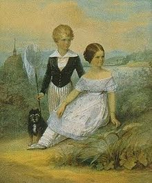 "Elisabeth at 11 years, her brother Karl Theodor, Duke in Bavaria, and their dog ""Bummerl"" at Possenhofen Castle"