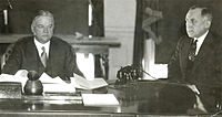 Herbert Hoover in the Oval Office with Ted Joslin. 1932