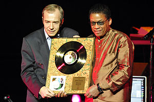 Hancock presented with Gold Record Award by Kazimierz Pułaski of Sony Music Poland. November 29, 2011