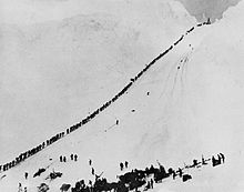 Miners and prospectors ascend the Chilkoot Trail during the Klondike Gold Rush