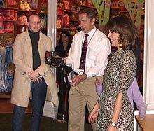 Grey with her husband, actor Clark Gregg (left) at the November 30, 2010 Epic Mickey launch party
