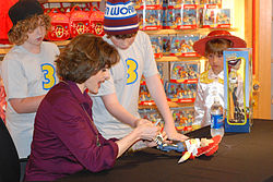Cusack pictured, autographing Toy Story 3 merchandise at an event