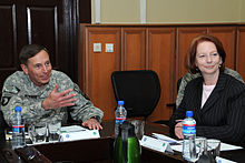 Gillard with General David Petraeus, the commander of the International Security Assistance Force, during a visit to Afghanistan on 2 October 2010