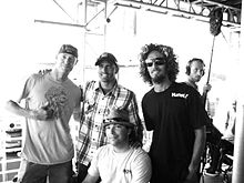Kelly Slater with fellow pro surfers Rob Machado and Christiaan Bailey
