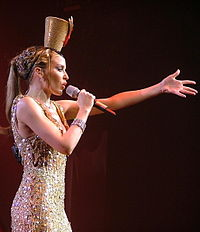 Minogue performing in Paris, France during the Showgirl: The Greatest Hits Tour (2005).