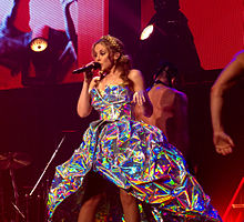 Minogue performing on her Aphrodite World Tour in Australia (2011).