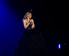 Minogue performing on her Aphrodite: Les Folies Tour, where she continued to tour in Japan when the 2011 Tōhoku earthquake and tsunami had struck (2011).