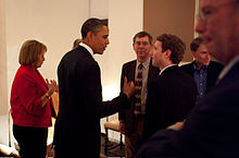 Zuckerberg listening to President Barack H. Obama before a private meeting where Obama dined with technology business leaders in Woodside, California, February 17, 2011. (Also pictured, from left: Carol Bartz of Yahoo!, Art Levinson of Genentech, Steve Westly of The Westly Group, and Eric Schmidt of Google.)