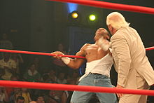 Flair delivering knife edge chops to Jay Lethal.