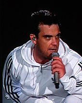 Robbie Williams at a concert in Vienna, Austria in 2006.