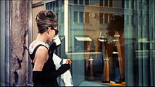 Hepburn in the opening scene of Breakfast at Tiffany's (1961), wearing the iconic little black dress by Givenchy