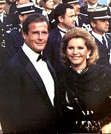 Roger Moore at the 1989 Cannes Film Festival with wife Luisa Mattioli.