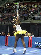Delivering a serve at an exhibition in November 2004.
