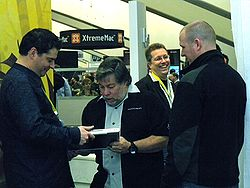 Steve Wozniak signs a Modbook for a fan during an appearance at the Axiotron booth during Macworld Expo 2009.