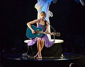 Swift performing during the Speak Now World Tour in 2011