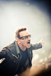 Bono performing with U2 in 2011