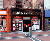 "The hearing aid shop, Bonavox, that provided Hewson with the nickname ""Bono Vox""."
