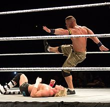 Cena delivers the Five Knuckle Shuffle to Dolph Ziggler.