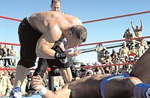 "Cena's delivers his signature taunt, ""U ₡ ME"", to Chris Masters."