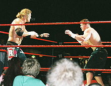 Cena facing off against Edge at a WWE house show.