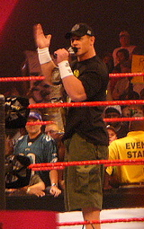 Cena, addressing fans at a Raw show