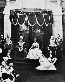 George VI grants Royal Assent to laws in the Canadian Senate, 19 May 1939. His consort, Queen Elizabeth, is to the right.