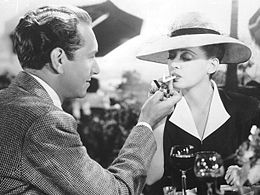 Paul Henreid lights Davis's cigarette in Now, Voyager (1942), one of her most iconic roles