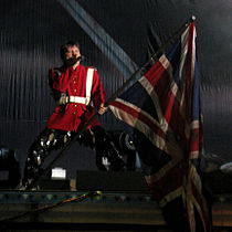 "Performing ""The Trooper"" with Iron Maiden in Paris, France, 1 July 2008. Dickinson has always waved a Union Flag during live renditions of the song.[73]"
