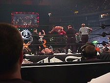 Benoit performing a diving headbutt on Rikishi at King of the Ring 2000.