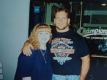 Benoit with a fan during his time in WCW.