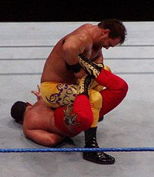 Chris Benoit performing the sharpshooter submission on Chavo Guerrero, Smackdown 2006.