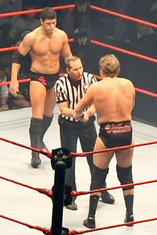 Cody Rhodes looks on as the referee admonishes William Regal during a bout in late 2007