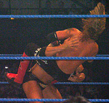 Batista performing a spinebuster to Edge.