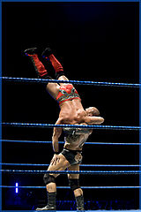 Batista delivering a suplex to Chris Jericho in September 2009.