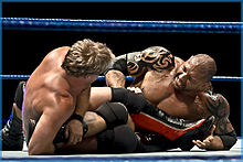 Chris Jericho applying a submission hold to Batista.